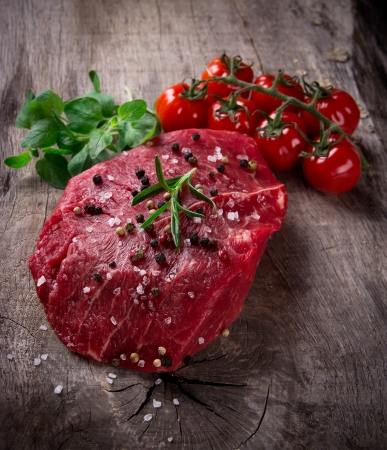 Raw beef steak on wooden table Stock Photo - 15764391