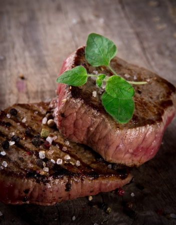 Grilled bbq steaks with fresh herb Stock Photo - 15764385