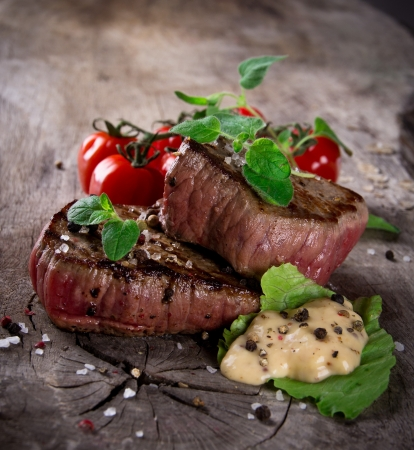 Grilled bbq steaks with fresh herbs and tomatoes Stock Photo - 15764372