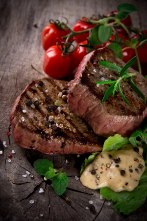 Grilled bbq steaks with fresh herbs and tomatoes Stock Photo - 15764396