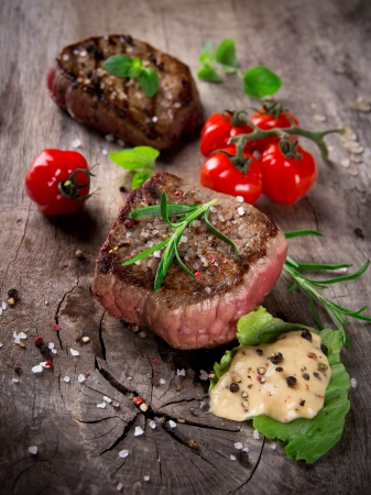 Grilled bbq steaks with fresh herbs and tomatoes Stock Photo - 15764387