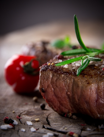 meat steak: Grilled bbq steaks with fresh herbs and tomatoes