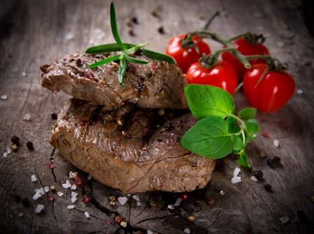 Grilled bbq steaks with fresh herbs and tomatoes Stock Photo - 15764389