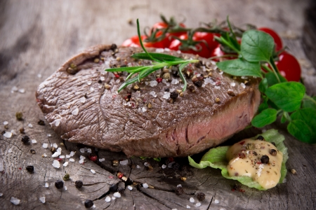 Grilled 500g bbq steak on wooden table Stock Photo - 15764398