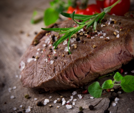 Grilled 500g bbq steak on wooden table Stock Photo - 15764384