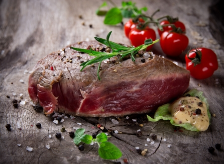 Medium Grilled 500g bbq steak on wooden table Stock Photo - 15764392