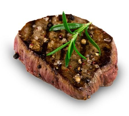 garnish: Grilled bbq steak on white background Stock Photo