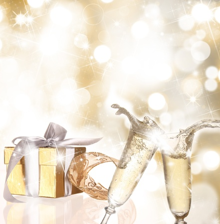 Champagne flutes with gold gift photo