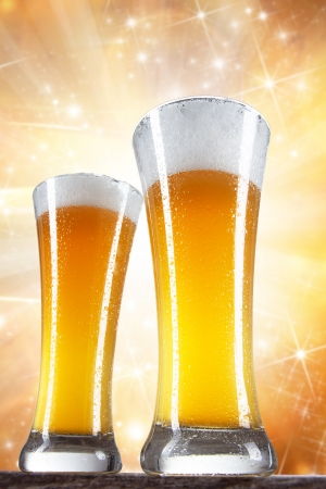 Beer glasses with gold background  photo