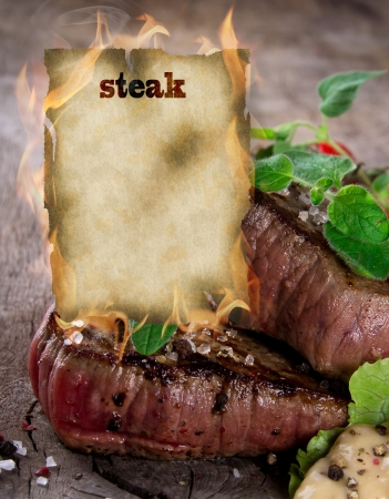 Raw beef steaks with burning blank paper Stock Photo - 15885775
