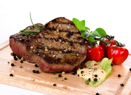 Grilled bbq steaks on white background Stock Photo - 15885768