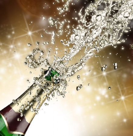 Close-up of champagne explosion   Stock Photo