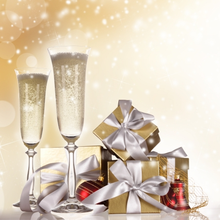 2 YEARS: Champagne flutes with gold gifts Stock Photo