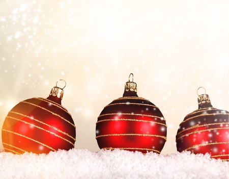 champagne flutes: Red christmas balls on snow