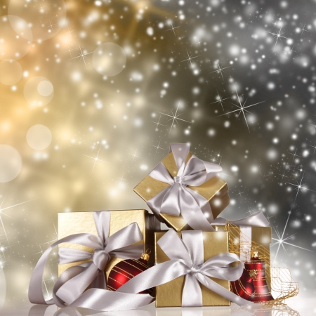 Christmas gifts with shining background Stock Photo - 16308877
