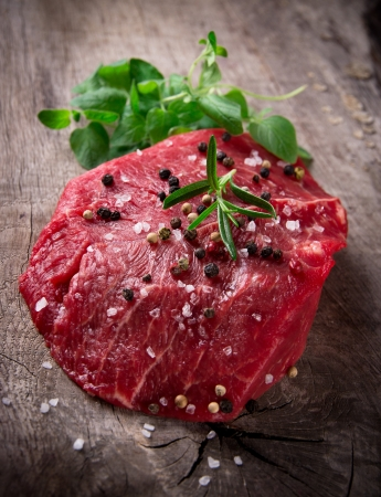 Raw beef steak on wooden table Stock Photo - 16308896
