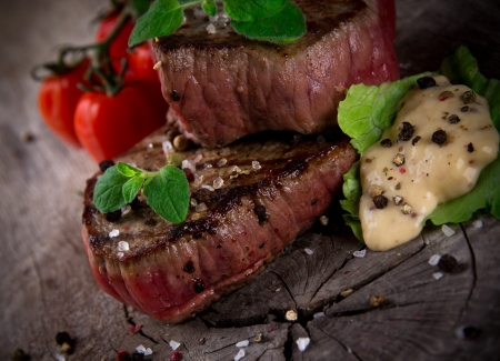 Grilled bbq steaks with fresh herbs and tomatoes Stock Photo - 16308894