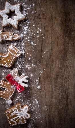 Traditional gingerbread cookies over wooden background Stock Photo