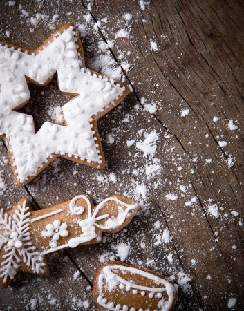 christmas cake: Traditional gingerbread cookies over wooden background Stock Photo