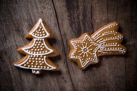 Traditional gingerbread cookies over wooden background photo
