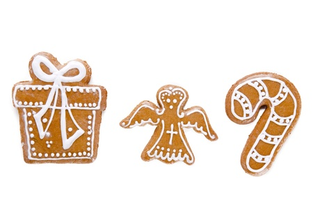 Traditional gingerbread cookies over white background photo