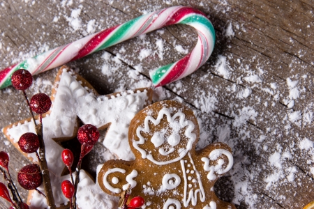 Traditional gingerbread cookies over wooden background Stock Photo - 16543329