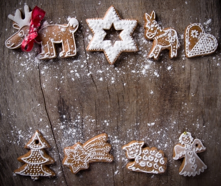 christmas gingerbread: Traditional gingerbread cookies over wooden background Stock Photo