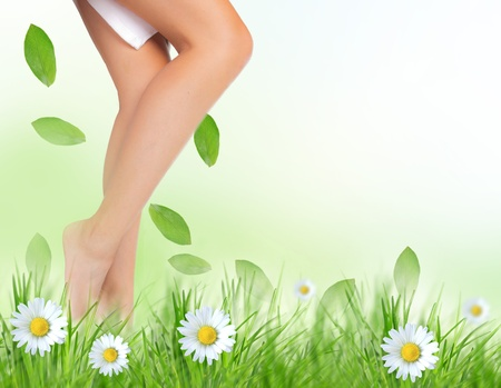 nude nature: Beautiful woman legs in a grass