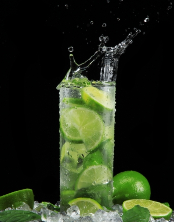 soda splash: Mojito cocktail on black background Stock Photo