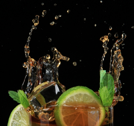 Cuba libre cocktail on black background Stock Photo