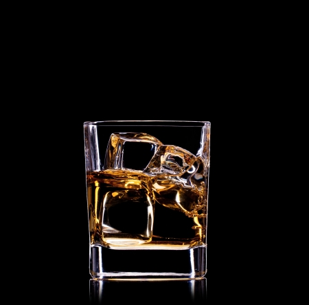 whiskey on the rocks: Close-up of glass with whisky  Stock Photo