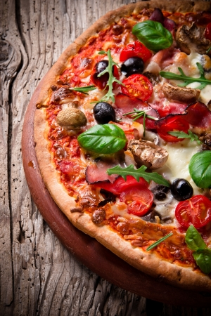 italian salami: Delicious italian pizza served on wooden table