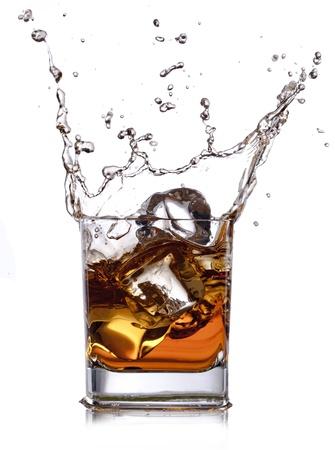 whiskey splash with ice cubes isolated on white Stock Photo - 17946881