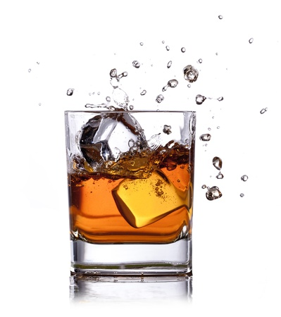 whiskey glass: whiskey splash with ice cubes isolated on white