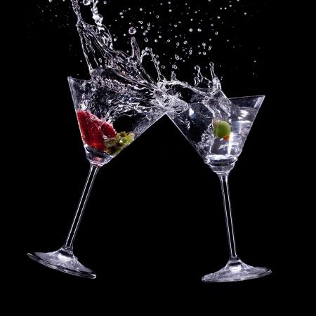 martini splash: martini drinks over dark background