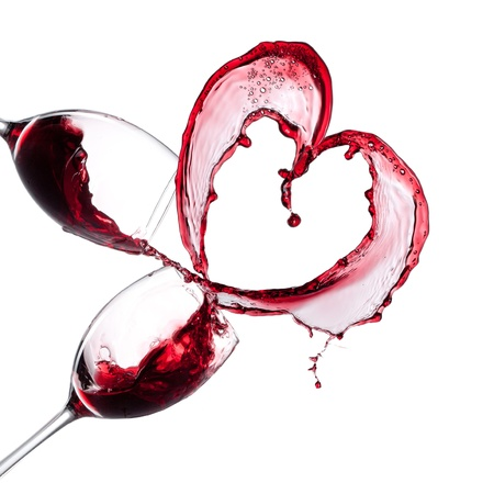 glass heart: Red wine heart over white background