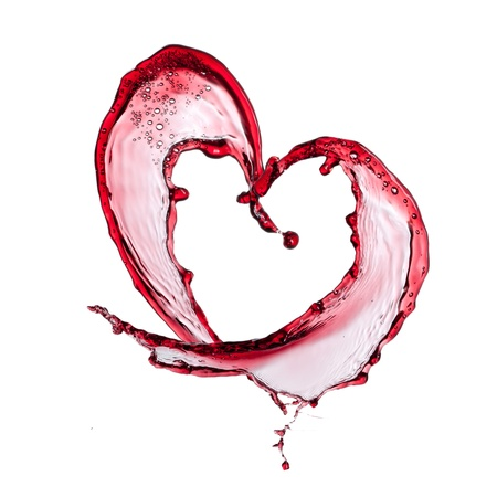 Red wine heart over white background photo