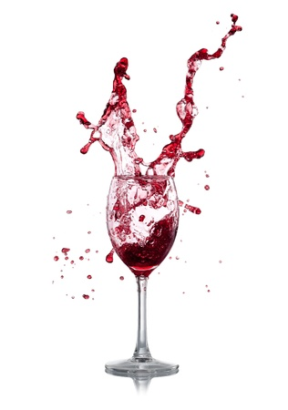 glass of red wine: Red wine splash over white background