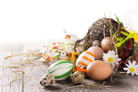 Colorful easter eggs with brown basket photo