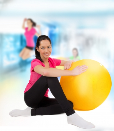 Happy young fitness woman with punch ball photo