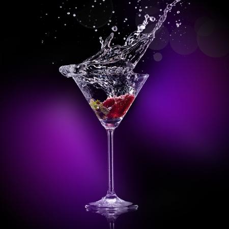martini splash: martini drink over dark background