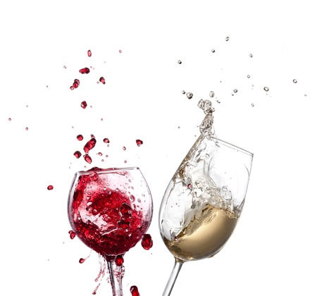 Wine splash over white background photo