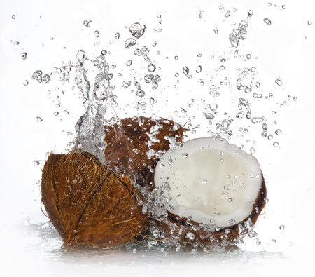 cracked coconut with splashing water  photo