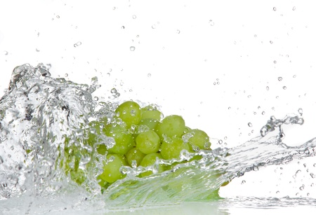 Grapes with water splash over white photo