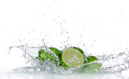 lime green: Limes with water splash isolated on white