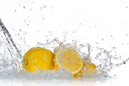 Lemon with water splash isolated on white  photo