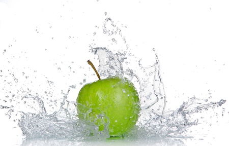 Apple with water splash isolated on white  photo
