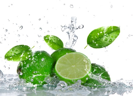 lime green background: Limes with water splash isolated on white