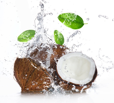 copra: cracked coconut with splashing water Stock Photo