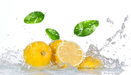 lemon water: Lemon with water splash isolated on white